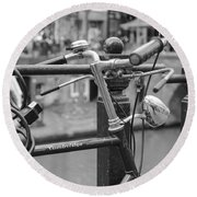 A Bicycle Parked At Fence, Netherlands Round Beach Towel
