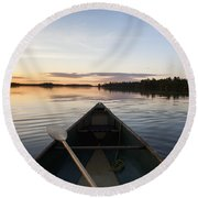 A Boat And Paddle On A Tranquil Lake Round Beach Towel