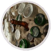 A Bottle In The Wall Round Beach Towel
