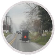 A Buggy Travels Down A Road In Spring Round Beach Towel