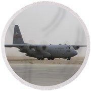 A C-130 Hercules Aircraft Taxis Round Beach Towel