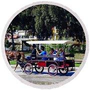 A Carriage Ride Through The Streets Of Katakolon Greece Round Beach Towel