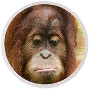 A Close Portrait Of A Sad Young Orangutan Round Beach Towel