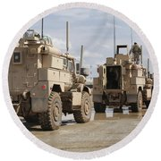 A Convoy Of Mrap Vehicles Near Camp Round Beach Towel