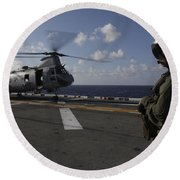 A Crew Chief Watches A Ch-46e Sea Round Beach Towel