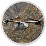 A Cv-22 Osprey Flies Over The Canyons Round Beach Towel by Stocktrek Images