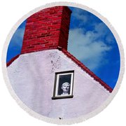 A Face At The Window Round Beach Towel