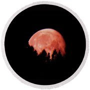A Full Moon Sinking Behind The Mountains  Round Beach Towel
