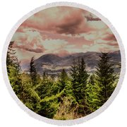 A Glimpse Of The Mountains Round Beach Towel