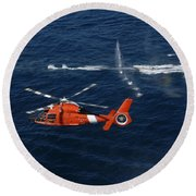A Helicopter Crew Trains Off The Coast Round Beach Towel by Stocktrek Images