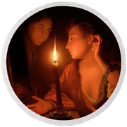 A Lady Admiring An Earring By Candlelight Round Beach Towel