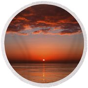 A Layer Of Clouds Is Lit By The Rising Round Beach Towel
