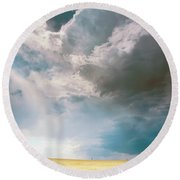 A Light In The Storm Round Beach Towel