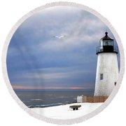 A Lonely Seagull Was Flying Over The Pemaquid Point Lighthouse Round Beach Towel