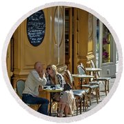 A Man A Woman A French Cafe Round Beach Towel