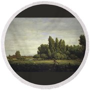 A Meadow Bordered By Trees Round Beach Towel