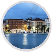 A Night View Of Split Old Town Waterfront In Croatia Round Beach Towel