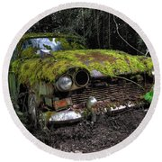 A Non Rolling Car Gathers Some Moss Round Beach Towel