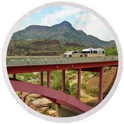 A Pickup Pulling A Travel Trailer Across The Salt River Canyon B Round Beach Towel