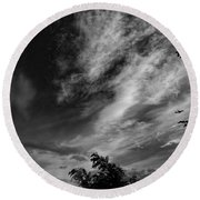 A Plane In The Clouds Round Beach Towel