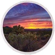 A Red Hot Desert Sunset Round Beach Towel