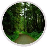 A Road Through The Forest Round Beach Towel