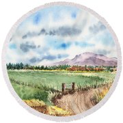 A Road To The Mountain Round Beach Towel