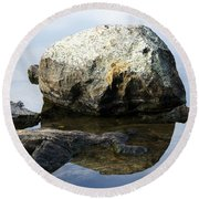 A Rock In Still Water Round Beach Towel