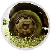 A Rolling Tire Gathers No Moss Round Beach Towel