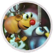 A Rudolph The Red Nosed Reindeer Ornament With A Penguin Round Beach Towel