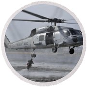 A Search And Rescue Swimmer Jumps Round Beach Towel