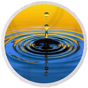 A Small Drop Of Hope Round Beach Towel
