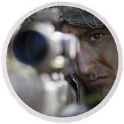 A Sniper Sights In On A Target Round Beach Towel by Stocktrek Images