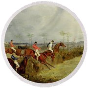 A Steeplechase - Taking A Hedge And Ditch  Round Beach Towel by Henry Thomas Alken