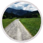 A Stone Path Through The Countryside Into The Forest Round Beach Towel