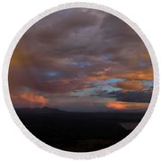 A Storm At Sunset Round Beach Towel