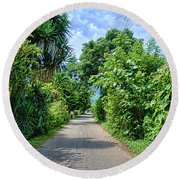 A Street Between Trees Round Beach Towel