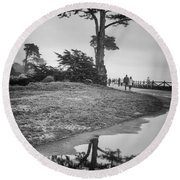 A Tree Stands Tall Round Beach Towel