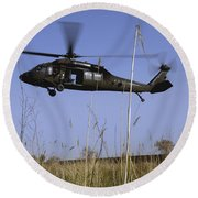 A U.s. Army Uh-60 Black Hawk Helicopter Round Beach Towel by Stocktrek Images