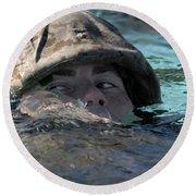 A U.s. Marine Swims Across A Training Round Beach Towel