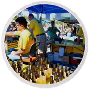 A Vendor At The Garlic Fest Offers Garlic Vinegar And Olive Oil For Sale Round Beach Towel
