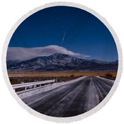 A Winters Meteor Round Beach Towel
