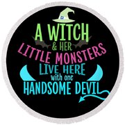 A Witch And Her Little Monsters Live Here With One Handsome Devil Halloween Round Beach Towel