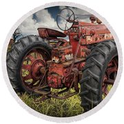 Abandoned Old Farmall Tractor In A Grassy Field Round Beach Towel