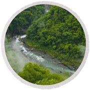 Above The River Round Beach Towel