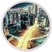 Aerial View Of Dubai's Business Bay At Night. Round Beach Towel