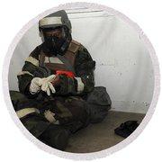 Airman Dons His Chemical Warfare Round Beach Towel