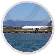 airplane on airport Corfu island Greece Round Beach Towel
