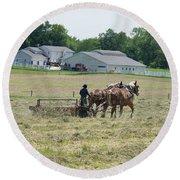 Amish Girl Raking Hay Photo Round Beach Towel