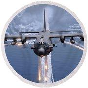 An Ac-130h Gunship Aircraft Jettisons Round Beach Towel